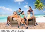 Купить «friends sitting on sofa over tropical beach», фото № 29512282, снято 30 июня 2018 г. (c) Syda Productions / Фотобанк Лори