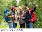 Купить «friends or travelers hiking with backpacks and map», фото № 29512298, снято 31 августа 2014 г. (c) Syda Productions / Фотобанк Лори