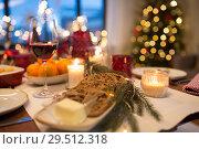 Купить «bread slices and other food on christmas table», фото № 29512318, снято 17 декабря 2017 г. (c) Syda Productions / Фотобанк Лори