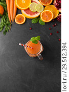 Купить «mason jar glass of fruit juice on slate table top», фото № 29512394, снято 4 апреля 2018 г. (c) Syda Productions / Фотобанк Лори