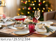 Купить «table setting for christmas dinner at home», фото № 29512594, снято 14 декабря 2017 г. (c) Syda Productions / Фотобанк Лори