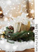 Купить «christmas gift and fir wreath with cones and balls», фото № 29512686, снято 15 ноября 2017 г. (c) Syda Productions / Фотобанк Лори