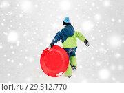 Купить «happy boy with snow saucer sled in winter», фото № 29512770, снято 10 февраля 2018 г. (c) Syda Productions / Фотобанк Лори