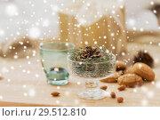 Купить «christmas fir decoration with cone in dessert bowl», фото № 29512810, снято 15 ноября 2017 г. (c) Syda Productions / Фотобанк Лори
