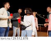 Купить «friends with drinks dancing at rooftop party», фото № 29512878, снято 2 сентября 2018 г. (c) Syda Productions / Фотобанк Лори