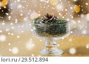 Купить «christmas fir decoration with cone in dessert bowl», фото № 29512894, снято 15 ноября 2017 г. (c) Syda Productions / Фотобанк Лори