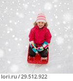 Купить «happy girl riding sled on snow in winter», фото № 29512922, снято 10 февраля 2018 г. (c) Syda Productions / Фотобанк Лори