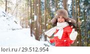 Купить «happy woman in fur hat over winter forest», фото № 29512954, снято 7 января 2017 г. (c) Syda Productions / Фотобанк Лори