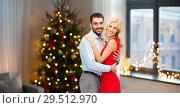 Купить «happy couple hugging at home on christmas», фото № 29512970, снято 3 октября 2015 г. (c) Syda Productions / Фотобанк Лори