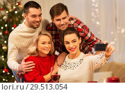Купить «friends taking selfie at christmas dinner», фото № 29513054, снято 17 декабря 2017 г. (c) Syda Productions / Фотобанк Лори