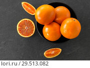 Купить «close up of fresh juicy blood oranges», фото № 29513082, снято 4 апреля 2018 г. (c) Syda Productions / Фотобанк Лори