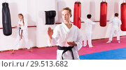 Купить «Preteen boy practicing karate movements with male trainer supervision», фото № 29513682, снято 3 июля 2020 г. (c) Яков Филимонов / Фотобанк Лори