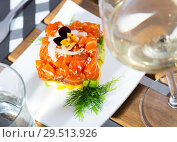 Купить «Cube of tasty tartar from red fish and avocado served on plate», фото № 29513926, снято 23 октября 2019 г. (c) Яков Филимонов / Фотобанк Лори