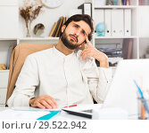 Купить «Office worker pondering work task», фото № 29522942, снято 27 июня 2019 г. (c) Яков Филимонов / Фотобанк Лори