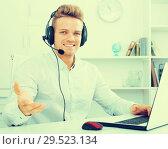 Купить «Portrait of young businessman with headset», фото № 29523134, снято 14 декабря 2019 г. (c) Яков Филимонов / Фотобанк Лори