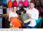 Купить «Couple choosing new sports bag», фото № 29523218, снято 22 ноября 2016 г. (c) Яков Филимонов / Фотобанк Лори