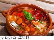 Купить «Bean's soup of broth cooked with boiled carrots, pepper and greens», фото № 29523418, снято 21 января 2019 г. (c) Яков Филимонов / Фотобанк Лори