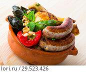Купить «Kapama a dish of bulgarian cuisine with assortiment meat, grape rolls», фото № 29523426, снято 15 декабря 2018 г. (c) Яков Филимонов / Фотобанк Лори