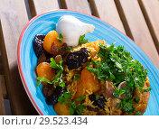 Купить «Pilaf from lamb, prunes, dried apricots», фото № 29523434, снято 20 апреля 2019 г. (c) Яков Филимонов / Фотобанк Лори