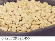Купить «Image of white cashew in container», фото № 29523450, снято 4 сентября 2017 г. (c) Яков Филимонов / Фотобанк Лори
