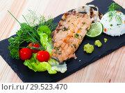 Купить «Deliciously fried trout fillet with rice and greens on black plate», фото № 29523470, снято 15 декабря 2018 г. (c) Яков Филимонов / Фотобанк Лори