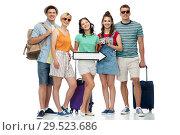 Купить «friends with travel bags, camera and arrow», фото № 29523686, снято 30 июня 2018 г. (c) Syda Productions / Фотобанк Лори