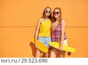 Купить «teenage girls with short skateboards outdoors», фото № 29523690, снято 19 июля 2018 г. (c) Syda Productions / Фотобанк Лори
