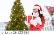 Купить «happy woman with gift over christmas tree», фото № 29523826, снято 7 января 2017 г. (c) Syda Productions / Фотобанк Лори