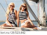Купить «beautiful women traveling by sail boat or yacht», фото № 29523842, снято 13 июля 2014 г. (c) Syda Productions / Фотобанк Лори
