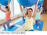 Купить «pregnant women training with exercise balls in gym», фото № 29523862, снято 5 марта 2016 г. (c) Syda Productions / Фотобанк Лори