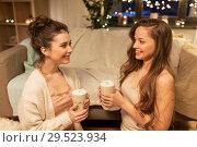 Купить «happy female friends drinking cacao at home», фото № 29523934, снято 21 января 2018 г. (c) Syda Productions / Фотобанк Лори
