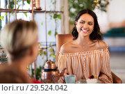 Купить «female friends drinking coffee and talking at cafe», фото № 29524042, снято 7 августа 2018 г. (c) Syda Productions / Фотобанк Лори