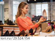 Купить «young woman choosing shoes at store», фото № 29524154, снято 22 сентября 2017 г. (c) Syda Productions / Фотобанк Лори