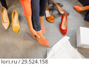 Купить «young woman trying high heeled shoes at store», фото № 29524158, снято 22 сентября 2017 г. (c) Syda Productions / Фотобанк Лори