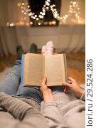 Купить «close up of couple reading book at home», фото № 29524286, снято 13 января 2018 г. (c) Syda Productions / Фотобанк Лори