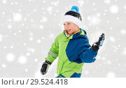 Купить «happy boy playing and throwing snowball in winter», фото № 29524418, снято 10 февраля 2018 г. (c) Syda Productions / Фотобанк Лори