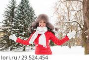 Купить «happy woman in fur hat over winter forest», фото № 29524454, снято 7 января 2017 г. (c) Syda Productions / Фотобанк Лори