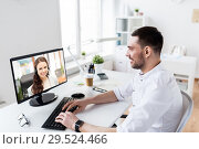 Купить «businessman having video call on pc at office», фото № 29524466, снято 9 марта 2017 г. (c) Syda Productions / Фотобанк Лори