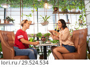 Купить «female friends drinking tea with cake at cafe», фото № 29524534, снято 7 августа 2018 г. (c) Syda Productions / Фотобанк Лори