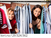 Купить «women having fun at vintage clothing store hanger», фото № 29524562, снято 7 августа 2018 г. (c) Syda Productions / Фотобанк Лори