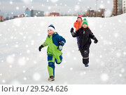 Купить «happy little kids playing outdoors in winter», фото № 29524626, снято 10 февраля 2018 г. (c) Syda Productions / Фотобанк Лори