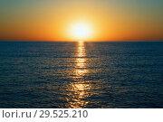 Купить «Sunrise on the black sea with glare on the water», фото № 29525210, снято 20 сентября 2018 г. (c) Алексей Маринченко / Фотобанк Лори