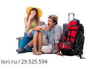 Купить «Young family preparing for vacation travel on white», фото № 29525594, снято 9 июля 2018 г. (c) Elnur / Фотобанк Лори