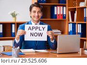 Купить «Young employee working in the office», фото № 29525606, снято 9 августа 2018 г. (c) Elnur / Фотобанк Лори