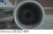 Купить «A closeup of an airplane engine», видеоролик № 29527454, снято 23 апреля 2018 г. (c) Данил Руденко / Фотобанк Лори