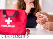 Купить «Young family getting treatment with first aid kit», фото № 29528510, снято 24 августа 2018 г. (c) Elnur / Фотобанк Лори