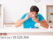 Купить «Man trying contact lenses at home», фото № 29529354, снято 6 августа 2018 г. (c) Elnur / Фотобанк Лори