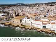 Купить «Aerial view of the beautiful town of Sitges in Spain», фото № 29530454, снято 26 марта 2018 г. (c) Яков Филимонов / Фотобанк Лори