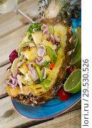 Купить «Plate with stuffed pineapple», фото № 29530526, снято 18 декабря 2018 г. (c) Яков Филимонов / Фотобанк Лори