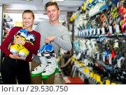 Купить «Customers are demonstrating their choice of boots», фото № 29530750, снято 31 июля 2017 г. (c) Яков Филимонов / Фотобанк Лори